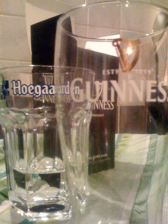 Two of the pint glasses I've received free with off-license beer purchase