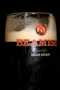 A partially enjoyed pint of Beamish