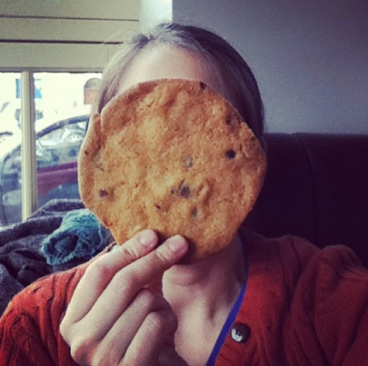Me holding up a gigantic cookie